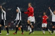 Inflected Berbatov holds Arsenal