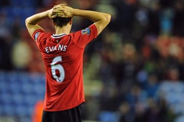 Jonny Evans hangs for the match with City