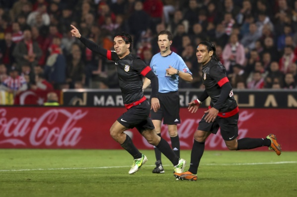 Atletico endured in Granada, took tenth victory