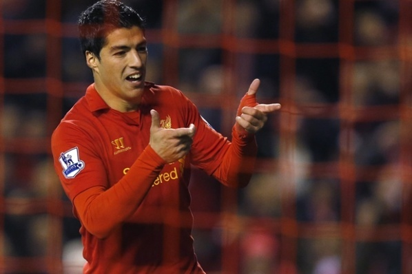 Liverpool punish their star Suarez