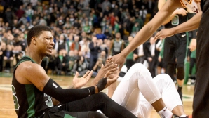 Daniel Theiss and Marcus Smart are injured in Boston