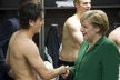 PICTURES: Angela Merkel congratulates German half-naked players